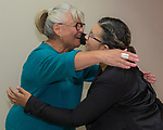 Nicole Barnes, right, gets a hug from President & CEO Isabelle Rodriguez Wilson during the Nevada Women's Fund Scholarship distribution, June 20, 2019.