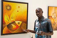 Artist Abdoukarim Fall, from Saint Louis, Displays his Work at Biannual Arts Festival, Goree Island, Senegal.