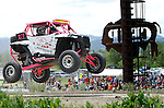 STURGIS, SD - JUNE 13: Matt Russell gets some air by the flag stang during the Liberty Super stores/Dakota Customs 250 short course baja race at the Buffalo Chip.  (Photo by Dick Carlson/Inertia)