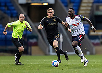 Bolton Wanderers' Ricardo Santos (right) breaks away from Oldham Athletic's Danny Rowe<br /> <br /> Photographer Andrew Kearns/CameraSport<br /> <br /> The EFL Sky Bet League Two - Bolton Wanderers v Oldham Athletic - Saturday 17th October 2020 - University of Bolton Stadium - Bolton<br /> <br /> World Copyright © 2020 CameraSport. All rights reserved. 43 Linden Ave. Countesthorpe. Leicester. England. LE8 5PG - Tel: +44 (0) 116 277 4147 - admin@camerasport.com - www.camerasport.com
