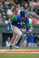 SHortstop Cristian Perez (15) of the Lexington Legends runs to first base during a game against the Greenville Drive on Sunday, September 2, 2018, at Fluor Field at the West End in Greenville, South Carolina. Greenville won, 7-4. (Tom Priddy/Four Seam Images)