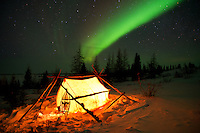 At 40 below zero the skies of northern Canada dances with lights from the heavens as stars twinkled and shoot through the night sky.