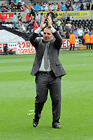 Pictured: A delighted Brendan Rodgers, manager for Swansea, thanking his supporters after his 4-0 win. Saturday 07 May 2011<br /> Re: Swansea City FC v Sheffield United, npower Championship at the Liberty Stadium, Swansea, south Wales.