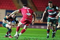 Greg Bateman of Leicester Tigers is tackled by Rob Evans of Scarlets during the Heineken Champions Cup round 5 match between the Scarlets and Leicester Tigers at the Parc Y Scarlets Stadium in Llanelli, Wales, UK. Saturday 12th January 2019