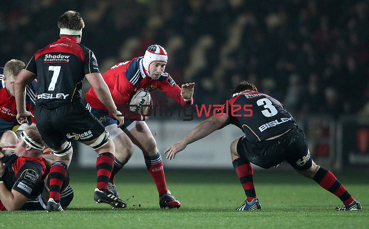 Johne Murphy of Munster Rugby looks to get past Tight-head prop Dan Way of Newport Gwent Dragons<br /> <br /> Guiness Pro 12<br /> Newport Gwent Dragons v Munster Rugby<br /> Rodney Parade<br /> 21.11.14<br /> ©Steve Pope-SPORTINGWALES