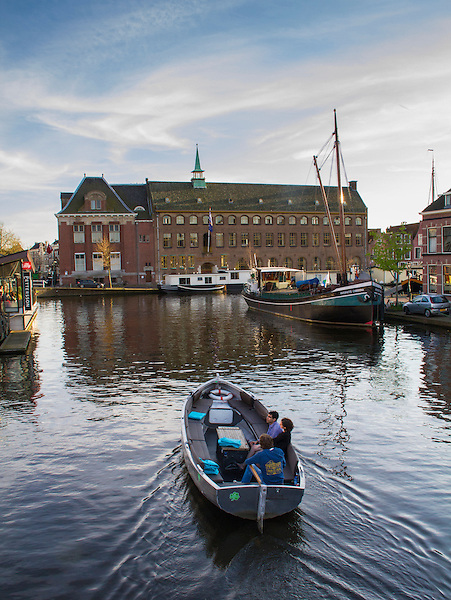 Boaters on a canal in Leiden, Netherlands .  John offers private photo tours in Denver, Boulder and throughout Colorado, USA.  Year-round. .  John offers private photo tours in Denver, Boulder and throughout Colorado. Year-round.