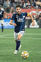 FOXBOROUGH, MA - SEPTEMBER 21: Carles Gil #22 of New England Revolution advances down the field during a game between Real Salt Lake and New England Revolution at Gillette Stadium on September 21, 2019 in Foxborough, Massachusetts.