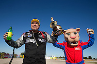 Sept. 22, 2013; Ennis, TX, USA: NHRA funny car driver Cruz Pedregon celebrates after winning the Fall Nationals at the Texas Motorplex. Mandatory Credit: Mark J. Rebilas-
