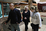 Officials from Sumerset, New Jersey escort Nancy Dunsavage through the Reno-Tahoe International Airport on Wednesday morning, Oct. 20, 2010, in Reno, Nev. Dunsavage was arrested in Incline Village, Nev. on Oct. 5, 2010, on charges related to the alleged abduction of her daughter in New Jersey 1984. .Photo by Cathleen Allison)