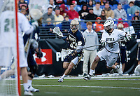 Kevin Moriarty (38) of Loyola tries to stop David Irving (33) of Notre Dame from moving towards goal during the Face-Off Classic in at M&T Stadium in Baltimore, MD