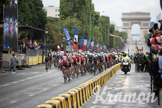 Team Lotto-Soudal taking the lead in the peloton to get André Greipel (DEU/Lotto-Soudal) into the front in the ultimate sprint finale<br /> <br /> stage 21: Sèvres - Champs Elysées (109km)<br /> 2015 Tour de France