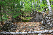 Remnants of the Number 2 Dam on the East Branch of the Pemigewasset River in Lincoln, New Hampshire. These concrete footings held the steel penstock that connected the dam to the Number 2 Powerhouse that was a short distance downriver. Built in the early 1900s, this dam was located east of Loon Mountain on the East Branch. And historical references refer to this dam by different names, but the No. 2 Dam seems to be the name most used.