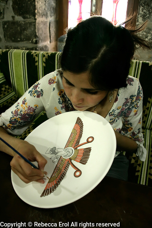 Painting a faravahar, the zoroastrian symbol, onto a ceramic at Nur Cin at the Pasha Han, Diyarbakir, southeastern Turkey