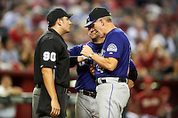 Colorado Rockies manager Jim Tracy #4 argues a call with umpire Mark Ripperger showing the wrist of Andrew Brown #12 who claimed to be hit by a pitch during a National League regular season game against the Arizona Diamondbacks at Chase Field on October 3, 2012 in Phoenix, Arizona. Colorado defeated Arizona 2-1. (Mike Janes/Four Seam Images)