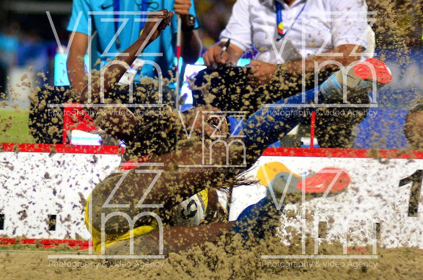 BARRANQUILLA - COLOMBIA, 01-08-2018: Catherine Ibargüen, de Colombia, durante su participación en la prueba de Salto Triple Mujeres, en el Estadio de Atletismo Rafael Cotes, como parte de los Juegos Centroamericanos y del Caribe Barranquilla 2018. / Catherine Ibargüen, from Colombia, during his participation in the Triple Jump Women test, at the Rafael Cotes Athletics Stadium, as a part of the Central American and Caribbean Sports Games Barranquilla 2018. Photo: VizzorImage / Alfonso Cervantes / Cont.