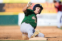 Patrick Biondi (5) of the Savannah Sand Gnats slides into third base after hitting a triple against the Hickory Crawdads at L.P. Frans Stadium on June 14, 2015 in Hickory, North Carolina.  The Crawdads defeated the Sand Gnats 8-1.  (Brian Westerholt/Four Seam Images)