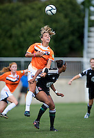 Maddy Brown (4) of the D.C. United Women has the ball headed away from her by Shelly Lyle (88) of the Charlotte Lady Eagles during the game at the Maryland SoccerPlex in Boyds, Maryland.  The D.C. United Women defeated the Charlotte Lady Eagles, 3-0, to win the W-League Eastern Conference Championship.