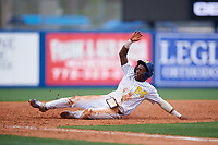 Michigan Wolverines right fielder Christan Bullock (5) slides safely into third base during a game against Army West Point on February 18, 2018 at Tradition Field in St. Lucie, Florida.  Michigan defeated Army 7-3.  (Mike Janes/Four Seam Images)