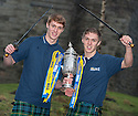 Falkirk players Jay (left) and Dale Fulton (right) get their hands on the Scottish Cup ahead of their game against Forfar.