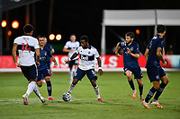 LAKE BUENA VISTA, FL - JULY 26: Cristian Dájome of Vancouver Whitecaps FC is surrounded by opponents during a game between Vancouver Whitecaps and Sporting Kansas City at ESPN Wide World of Sports on July 26, 2020 in Lake Buena Vista, Florida.