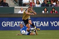 USA's Abby Wambach (20) gets taken down by Finland's Marian Dalmy (2). The USA women's national team defeated Finland 4-0 at the Home Depot Center in Carson, CA, on August 25, 2007. (Photo by Matt A. Brown/ISIphotos.com)