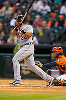 Detroit Tigers third baseman Miguel Cabrera (24) hits a double to right field during fourth inning of the MLB baseball game against the Houston Astros on May 3, 2013 at Minute Maid Park in Houston, Texas. Detroit defeated Houston 4-3. (Andrew Woolley/Four Seam Images).