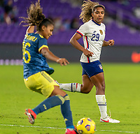 ORLANDO, FL - JANUARY 18: Jorelyn Carabali #16 of Colombia is defended by Catarina Macario #29 of the USWNT during a game between Colombia and USWNT at Exploria Stadium on January 18, 2021 in Orlando, Florida.