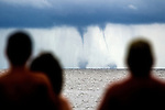 Twin waterspouts form off Shell Point Beach in Wakulla County, Florida.<br /> ©2013 Mark Wallheiser