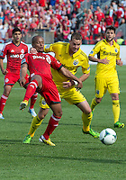 18 May 2013: Toronto FC forward Robert Earnshaw #10 and Columbus Crew defender Josh Williams #3 in action during an MLS game between the Columbus Crew and Toronto FC at BMO Field in Toronto, Ontario Canada..The Columbus Crew won 1-0...