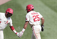 Arkansas outfielder Christian Franklin (25) returns to the dugout following a score, Saturday, April 3, 2021 during the sixth inning of a baseball game at Baum-Walker Stadium in Fayetteville. Check out nwaonline.com/210404Daily/ for today's photo gallery. <br /> (NWA Democrat-Gazette/Charlie Kaijo)