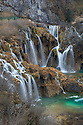 A series of waterfalls known as 'Sastavci' that cascade between mountain lakes, Plitvice Lakes National Park, Croatia. January.