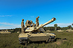 """American soldiers with Delta Company, 2nd Battalion, 7th Infantry Regiment, 1st Armored Brigade Combat Team, 3rd Infantry Division with M1A2 Abrams tanks before a tank training exercise practicing infiltration at the Drawsko Pomorskie Training Area in Poland on June 12, 2015.    NATO is engaged in a multilateral training exercise """"Saber Strike,"""" the first time Poland has hosted such war games, involving the militaries of Canada, Denmark, Germany, Poland, and the United States."""