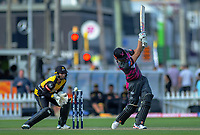 Northern's Daryl Mitchell swings and misses as Wellington's Devon Conway keeps during the Dream11 Super Smash cricket match between the Wellington Firebirds and Northern Knights at Basin Reserve in Wellington, New Zealand on Friday, 3 January 2020. Photo: Dave Lintott / lintottphoto.co.nz