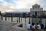 78th Venice Film Festival  at the Lido in Venice, Italy on September 7, 2021. A family in front of Grand canal and Santa Chiara Railway station
