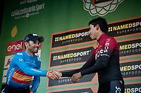 2nd Alejandro Valverde (ESP/Movistar) congratulating 3rd finisher Egan Bernal (COL/Ineos) on the podium<br /> <br /> 113th Il Lombardia 2019 (1.UWT)<br /> 1 day race from Bergamo to Como (ITA/243km)<br /> <br /> ©kramon