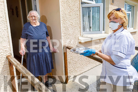 Nellie Doran from Headleys Bridge receiving her Meals on Wheels from Breda Walsh Mangan of the Knocknagoshel Over 55's Social Club on Saturday