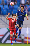 Yoshida Maya of Japan (R) fights for the ball with Nguyen Cong Phuong of Vietnam (L) during the AFC Asian Cup UAE 2019 Quarter Finals match between Vietnam (VIE) and Japan (JPN) at Al Maktoum Stadium on 24 January 2018 in Dubai, United Arab Emirates. Photo by Marcio Rodrigo Machado / Power Sport Images