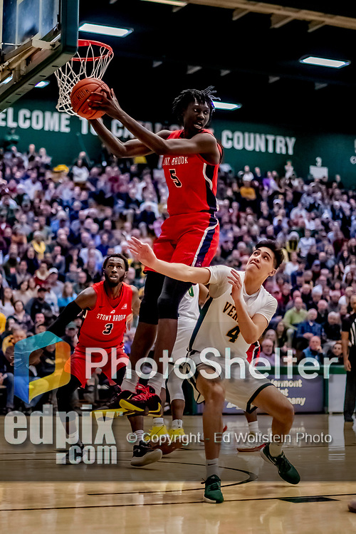 8 January 2020: Stony Brook University Seawolf Forward Mouhamadou Gueye, a Junior from Staten Island, NY, pulls in a rebound during second half action against the University of Vermont Catamounts at Patrick Gymnasium in Burlington, Vermont. The Seawolves defeated the Catamounts 81-77 in a closely fought game. Mandatory Credit: Ed Wolfstein Photo *** RAW (NEF) Image File Available ***