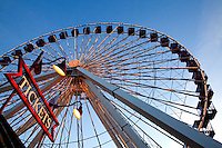 A giant Ferris wheel (150-foot-high Ferris wheel) makes a graphic contrast to the late afternoon sky at Chicago's Navy Pier on Lake Michigan near downtown Chicago, Ill. Navy Pier is a 50-acre park and promenade in downtown Chicago.