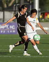23 July 2009:  Brandi Chastain of the FC Gold Pride kicks the ball away from Aya Miyama of the Los Angeles Sol during the first half of the game at Buck Shaw Stadium in Santa Clara, California.   FC Gold Pride tied Los Angeles Sol, 0-0.