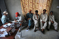 Refugees from Swat district receive medical care from a doctor in the Swabi Refugee camp. The camp is run by Red Cross/Red Crescent (ICRC), and currently houses around 18,000 refugees. The Pakistani government began an offensive against the Taliban in the Swat Valley in April 2009, which led to a major humanitarian crisis. Up to two million civilians were estimated to have been displaced by the fighting.