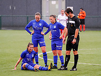 Genk's Kayleigh Rigo (16) injured, on the ground, Genk's Dorien Groven (4) (L), Genk's Sofie Ketelslegers (24) (M) and match referee Andy De Ketelaere  wait for the arrival of the medic during a female soccer game between the women teams of Zulte Waregem A Dames and KRC Genk Ladies B on the 1/16 th qualifying round for the Belgian Womens Cup 2020  2021 , on saturday 26 th of September 2020  in Zulte , Belgium . PHOTO SPORTPIX.BE | SPP | SEVIL OKTEM