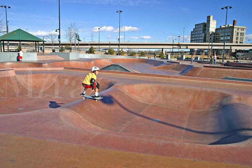 Children skateboarding Denver Skatepark Colorado