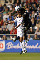 Sean Franklin (5) of the Los Angeles Galaxy and Sheanon Williams (25) of the Philadelphia Union go up for a header. The Philadelphia Union  and the Los Angeles Galaxy played to a 1-1 tie during a Major League Soccer (MLS) match at PPL Park in Chester, PA, on May 11, 2011.