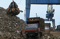 Indonesia Java Jakarta, unloading of steel scrap from Europe in harbour  / Indonesien Java Jakarta, Anlandung von Schrott Aus Europa im Hafen von Jakarta