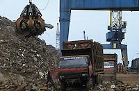 Indonesia Java Jakarta, unloading of steel scrap from Europe in harbour  / Indonesien Java Jakarta, Anlandung von Schrott Aus Europa im Hafen von Jakarta
