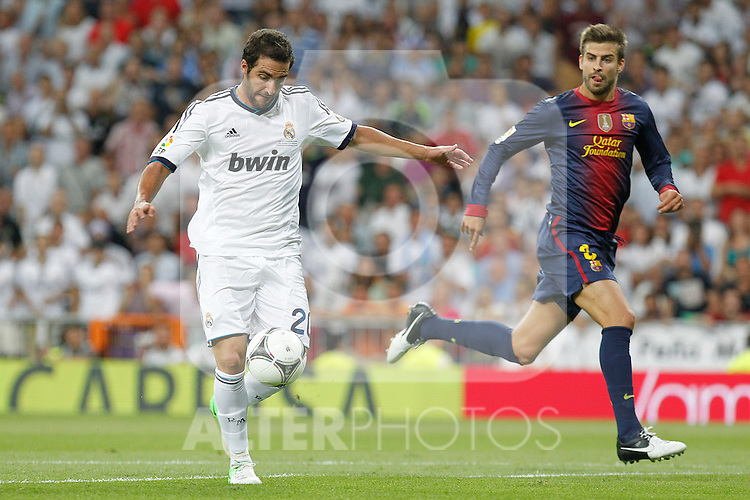 Real Madrid's Gonzalo Higuain and F.C. Barcelona's Gerard Pique during Spanish Supercup 2nd match on august 29 2012...Photo: Alex Cid-Fuentes / ALFAQUI
