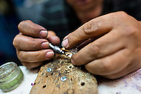 A Colombian jeweler works on a ring in the jewelry workshop in Bogota, Colombia, 8 February 2014. Around 60% of the world's emerald production come from Colombia. Most of the gemstones are cut, faceted and processed into jewelry in the workshops located in the emerald district in downtown Bogota. There are approximately 2000 jewelers working in the emerald district. Due to their special clarity and deep vivid green color, Colombian emeralds are considered the most beautiful in the world.