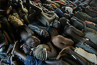 Malawi: Blantyre: June 29, 2005: At a prison in Malawi, inmates sleep on the floor, so tightly packed that they turn only when a designated prisoner wakes them to do so en masse.