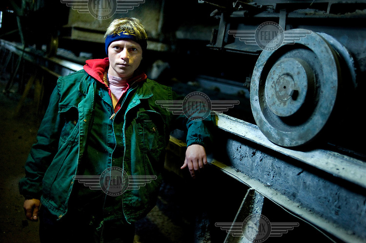 36 year old Corina Cirlig works loading coal into carriages for transportation to the surface at the Petrila mine..